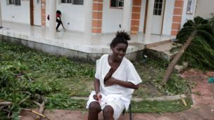 Emma Etienne waits to find a doctor to deliver her baby at temporary shelter Hotel Villa Mimosa following Hurricane Matthew in Les Cayes, Haiti