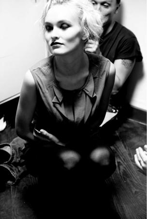 A model poses backstage