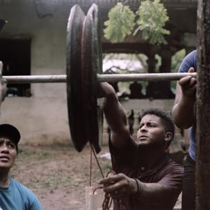 Ron, 21, Wesley, 20 and Lucy work on building a rope pump in Bilwi, Nicaragua