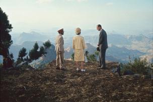 Emperor of Ethiopia Haile Selassie (1892 - 1975), Queen Elizabeth II, and her husband, Prince Philip, Duke of Edinburgh stand on a cliff that overlooks Blue Nile Falls, near Lake Tana, Ethiopia, 5 February 1965.