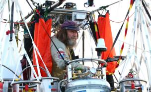 Mid-shot of Fedor Konyukhov on board his balloon and preparing for lift off from the Northam Aero Club on 12 July 2016.