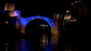 Old Bridge in Mostar illuminated in United Kingdom's flag colours.