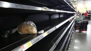 Consumers find the bread aisle at a local Walmart supermarket emptied out in Kissimmee, Florida in preparation for the landfall of Hurricane Matthew, on October 6, 2016.