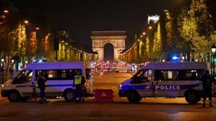 Police secure the area after a gunman opened fire on Champs Elysees in Paris, 20 April 2017
