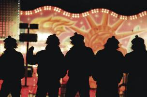 Five men enjoying Edinburgh Hogmanay celebrations.