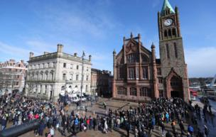 Outside the Guildhall crowds of people gathered to show their support for victims' families.