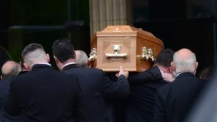 Lyra McKee's coffin is carried into the church