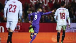 Karim Benzema celebrates scoring against Sevilla