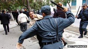 Police beating demonstrators in Baku