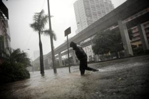 A local resident walks across a flooded street in downtown Miami as Hurricane Irma arrives at south Florida, 10 September