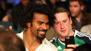 A Northern Ireland fan grabs a snap with former WBA heavyweight champion David Haye