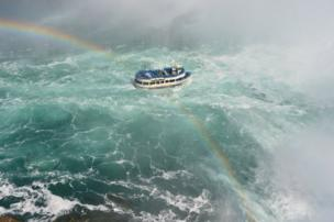A boat crossed by a rainbow