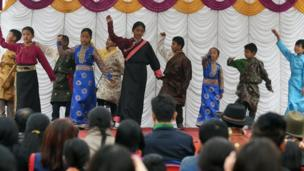 Young exiled Tibetans dance during celebrations marking the Lunar New Year or Sonam Lhosar in Kathmandu on February 16, 2018