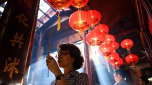 Prayers and incense on the first day of the Lunar New Year at Sin Sze Si Ya Temple in Kuala Lumpur, Malaysia, on February 16, 2018,