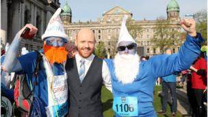 BBC NI's Barra Best with runners dressed as smurfs outside Belfast City Hall, Belfast City Marathon, 1 May 2017