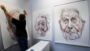 Jacques Bauer paintings are hung ahead of the start of a contemporary fair in Strasbourg