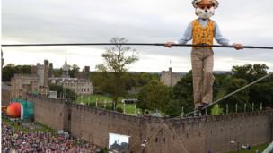 Mr Fox tightrope walks by Cardiff Castle