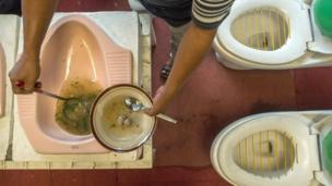 Well, it doesn't get much weirder than this! A toilet themed cafe from Indonesia. Customers sit on the loo and eat out of toilet pans. So, what's on the men-poo? They only have one option and it's brown meatballs floating in thick soup. Apparently it's part of a campaign to encourage the use of clean toilets. Hmmmm...