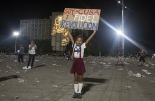 "A little girl poses holding a sign that reads in Spanish ""I am Cuba. Fidel. Revolution"" after a rally honouring the late Fidel Castro at Revolution Plaza in Havana, Cuba, Tuesday, Nov. 29, 2016."