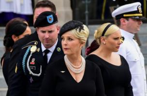 Cindy McCain (C) the widow of US Senator John McCain, and her sons and daughters