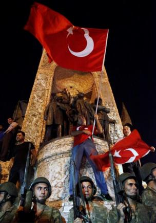 Turkish soldiers guard at the Taksim Square in Istanbul