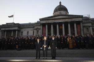 Mayor of London Sadiq Khan, Home Secretary Amber Rudd MP and acting Commissioner of the Metropolitan Police Craig Mackey stand in silence during a candlelit vigil at Trafalgar Square