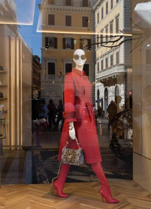 A mannequin in a red suit