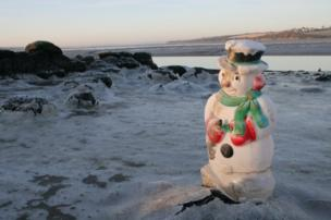 A snowman by the sea