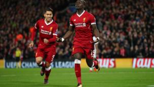 Sadio Mane of Liverpool celebrates after scoring his side's fourth goal with Roberto Firmino of Liverpool during the UEFA Champions League group E match between Liverpool FC and Spartak Moscow at Anfield on December 6, 2017 in Liverpool, United Kingdom.