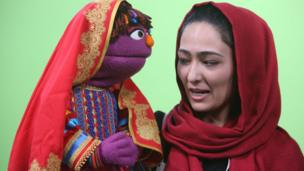 Afghan puppeteer Mansoora Shirzad, records a segment with Zari