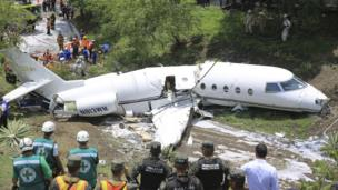 Authorities work in the area where an executive jet plane with US registration crashed in Tegucigalpa, Honduras