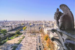 A gargoyle looks over Paris