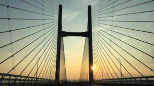 The sun peeking through the iconic Severn bridge, taken by Edd Thomas