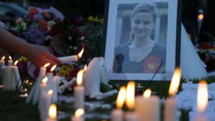 People light candles at the tribute in Parliament Square on 17 June 2016 in remembrance of Labour MP Jo Cox