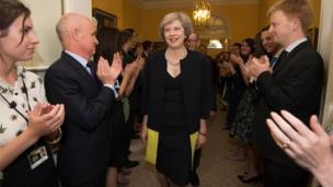 Mrs May welcomed by staff inside Number 10