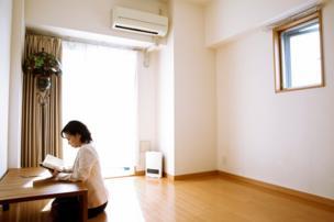 Minimalist Saeko Kushibiki demonstrates where she reads in her room in Fujisawa, south of Tokyo