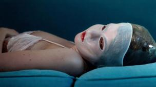 A woman lying with a mask on her face