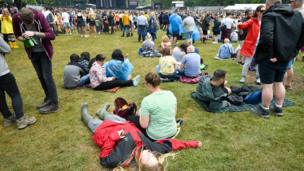 People relax away from the crowds during the first day of BBC Music's Biggest Weekend at Singleton Park, Swansea