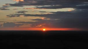 The sun setting over Oxford, from the Chilterns.