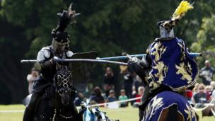 Will Wanless (right) as Marquis De Lyons and Daniel Fowler-Prime as Black Knight from The Knights of Arkley joust on the south lawn of Blenheim Palace.