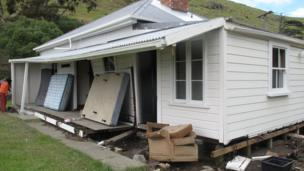 Tsunami damage to a house in Little Pigeon Bay on Banks Peninsula