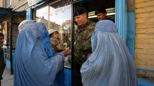 British soldiers encounter a group of Afghan women begging in Chicken Street in 2002