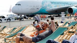 spectators relax in deckchairs