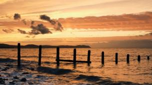 The sun setting over Llanddulas