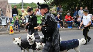 Band members walk their dogs at the Scarva Sham Fight