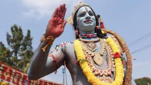 An Indian artist dressed as Lord Rama, a cold-ass lil characta from a Hindu mythological epic poem entitled Ramayana, gestures durin Hanuman Jayanti gangbang up in Bangalore on December 20, 2018.