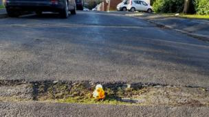 Rubber duck in the pothole in Surrey