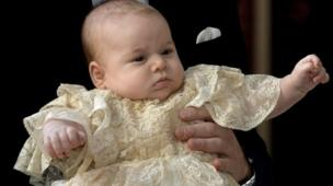23 October 2013: Prince George is held by his father on his christening day, as they arrive at the Chapel Royal in St James's Palace in London