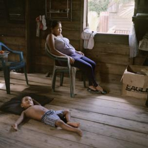 Bessy Cariela Morales Labonte and her brother relax at home in Bilwi, Nicaragua