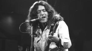 Rory Gallagher on stage at the Ulster Hall, Belfast, in 1977